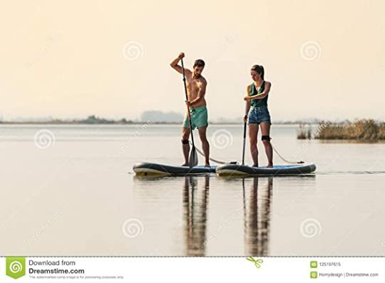 man and woman paddle boarding - Google Search