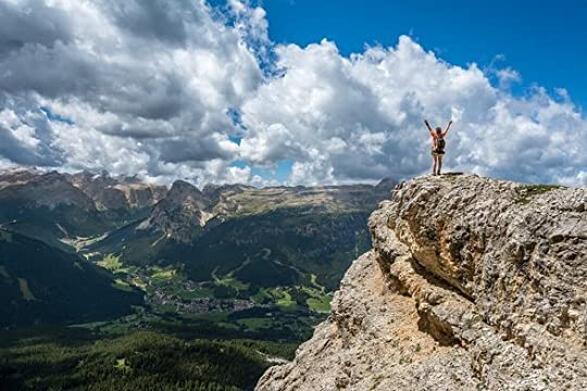 Woman on top mountain