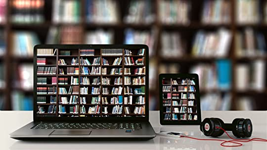 Books on shelves, leptop, tablet, and audio player
