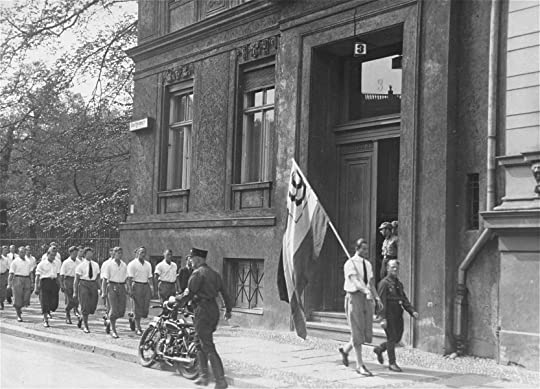 Students organized by the Nazi party parade in front of the building of the Institute for Sexual Research in Berlin prior to pillaging it on May 6, 1933.