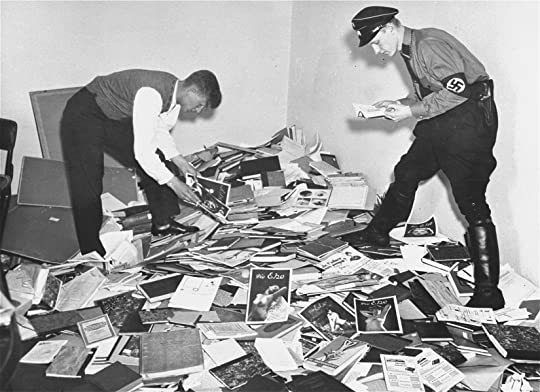 German students and Nazi SA plunder the library of Dr. Magnus Hirschfeld, Director of the Institute for Sexual Research in Berlin.