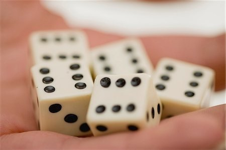 Hand holding dice Stock Photos - Page 1 : Masterfile