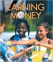 Earning Money (First Step Nonfiction: Money)  by  Tanya Thayer