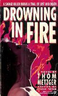 Drowning in Fire  by  Th. Metzger