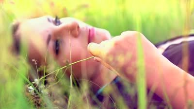 photo stock-footage-beautiful-girl-lying-on-the-meadow-and-dreaming-enjoy-nature-close-up-slow-motion-footage_zpsggnibzis.jpg